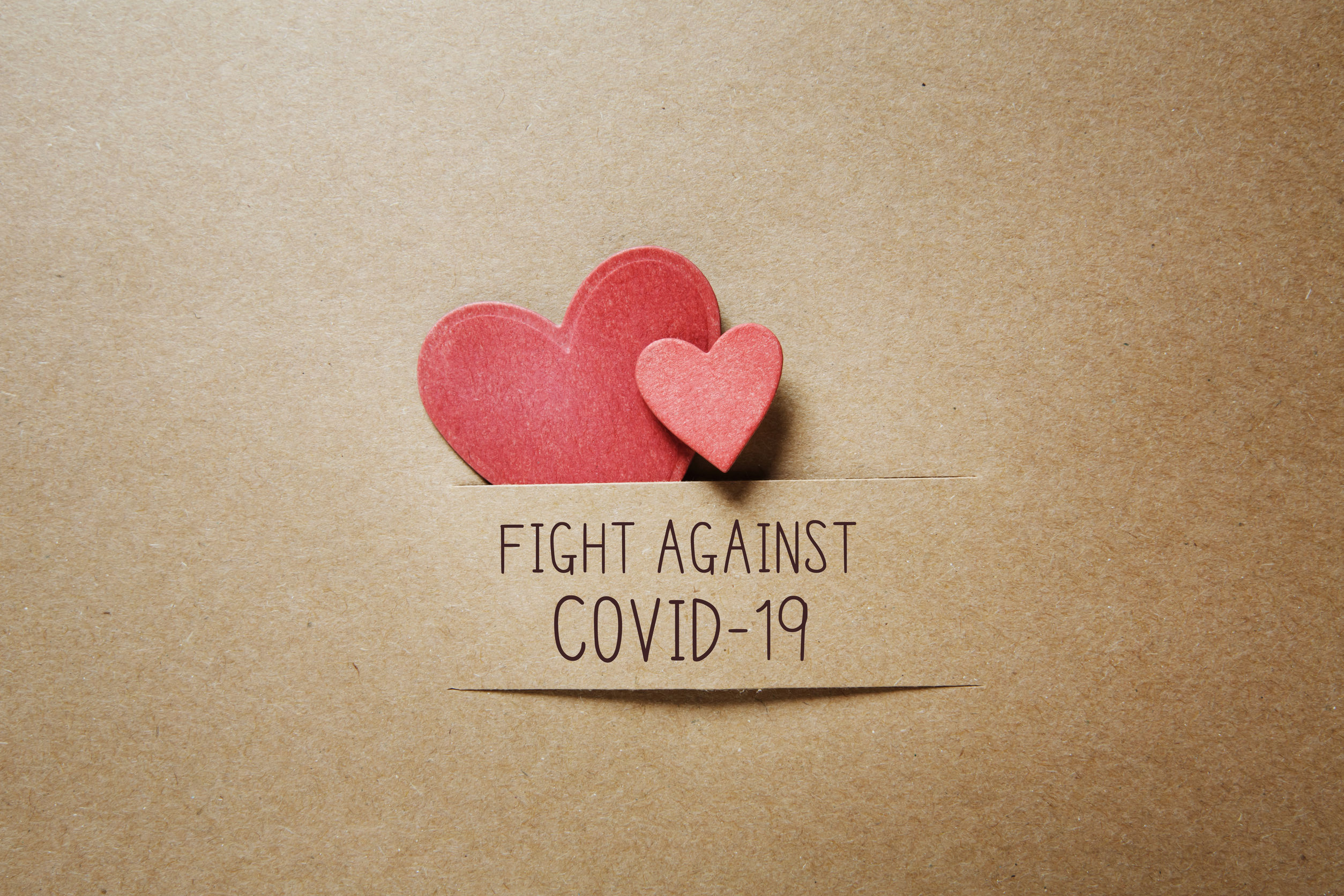 Fight Against Covid-19 message with handmade small paper hearts